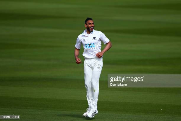 Ajmal Shahzad of Sussex celebrates after claiming the wicket of Sam Northeast of Kent during day one of the Specsavers County Championship Division...