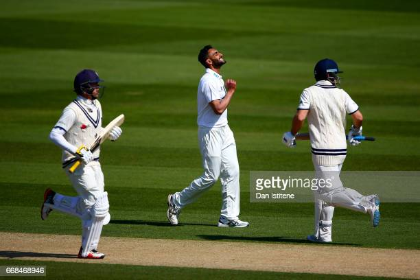 Ajmal Shahzad of Sussex reacts as Sean Dickson and Sam Northeast of Kent run a single during day one of the Specsavers County Championship Division...
