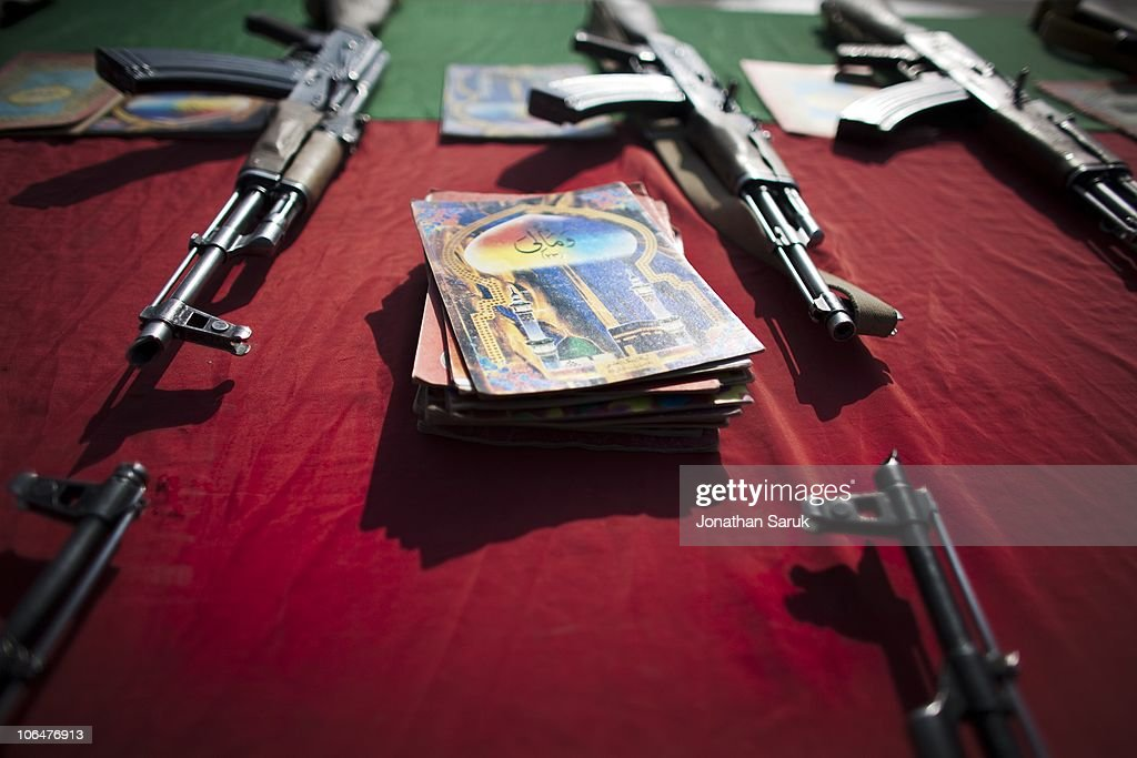 AK-47s and books with excerpts from the Koran lay on a table as soldiers of the Afghanistan National Army take an oath to defend their country during a mid-course ceremony at the Kabul Military Training Center March 19, 2009 in Kabul, Afghanistan. A group of 1,200 soldiers have completed five weeks of training of a ten week course. Approximately 25,000 soldiers a year graduate from the program located on the outskirts of Kabul. Increasing the number of Afghan soldiers is a major goal of coalition forces in Afghanistan.