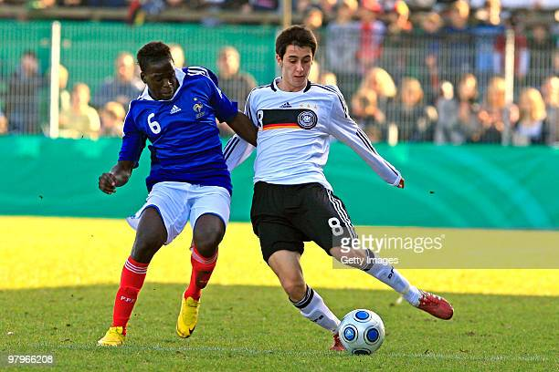 Akaki Gogia is challenged Christopher Missilou during the U18 international friendly match between Germany and France at the Arena Oldenburger...