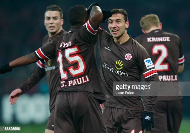 Akaki Gogia of St Pauli celebrates with his team mate JosephClaude Gyau after scoring his team's first goal during the Second Bundesliga match...