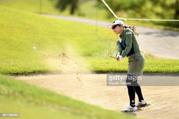 Akane Iijima of Japan hits from a bunker on the 8th hole during the first round of the Miyagi TV Cup Dunlop Ladies Open 2017 at the Rifu Golf Club on...