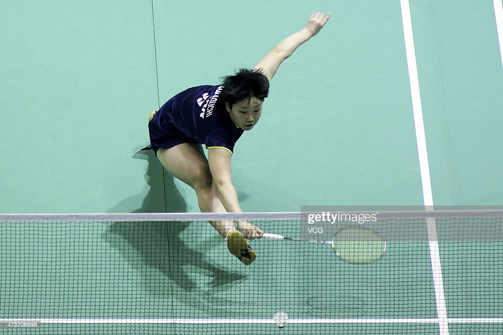 <a gi-track='captionPersonalityLinkClicked' href=/galleries/search?phrase=Akane+Yamaguchi&family=editorial&specificpeople=11382505 ng-click='$event.stopPropagation()'>Akane Yamaguchi</a> of Japan competes against Li Xuerui of China during Women's Singles match in the finals on day eight of 2015 Sudirman Cup BWF World Mixed Team Championships at Dongfeng Nissan Sports Center on May 17, 2015 in Dongguan, China.