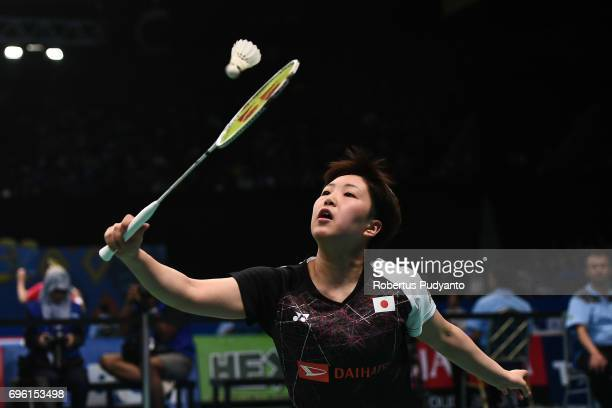 Akane Yamaguchi of Japan competes against Nozomi Okuhara of Japan during Womens Single Round 2 match of the BCA Indonesia Open 2017 at Plenary Hall...