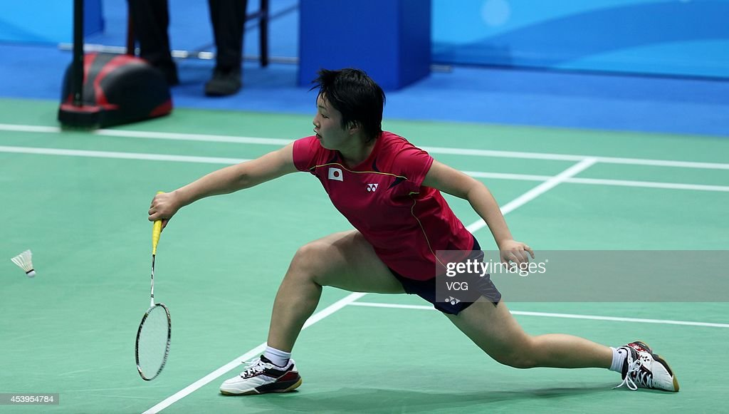 <a gi-track='captionPersonalityLinkClicked' href=/galleries/search?phrase=Akane+Yamaguchi&family=editorial&specificpeople=11382505 ng-click='$event.stopPropagation()'>Akane Yamaguchi</a> of Japan competes in the Women's Singles Gold Medal Match against He Bingjiao of China at Sport Institute Gymnasium during day six of the Nanjing 2014 Summer Youth Olympic Games on August 22, 2014 in Nanjing, China.
