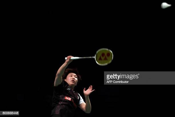 Akane Yamaguchi of Japan hits a return against compatriot Nozomi Okuhara in their Australian Open women's singles badminton final in Sydney on June...
