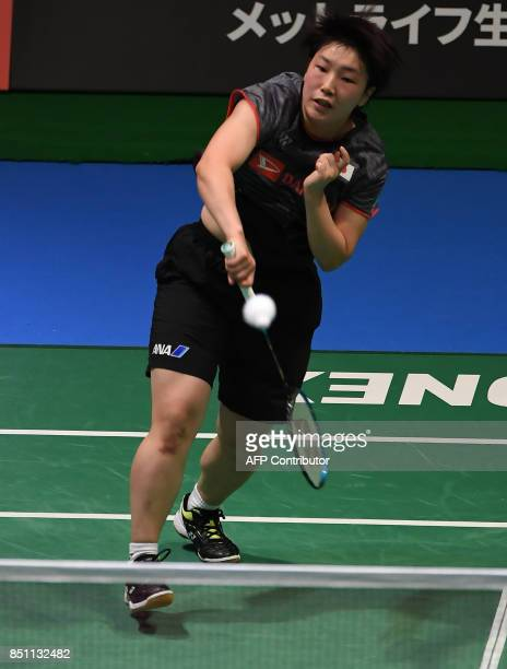 Akane Yamaguchi of Japan hits a return to Carolina Marin of Spain during the women's singles quarterfinal match at the Japan Open Badmintons...