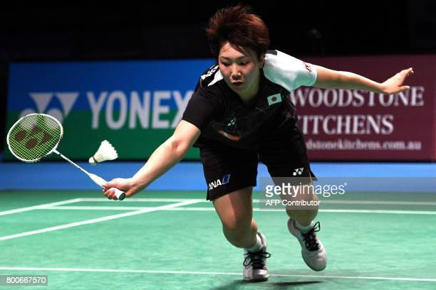 Akane Yamaguchi of Japan hits a return to compatriot Nozomi Okuhara during their Australian Open women's singles badminton final in Sydney on June 25...