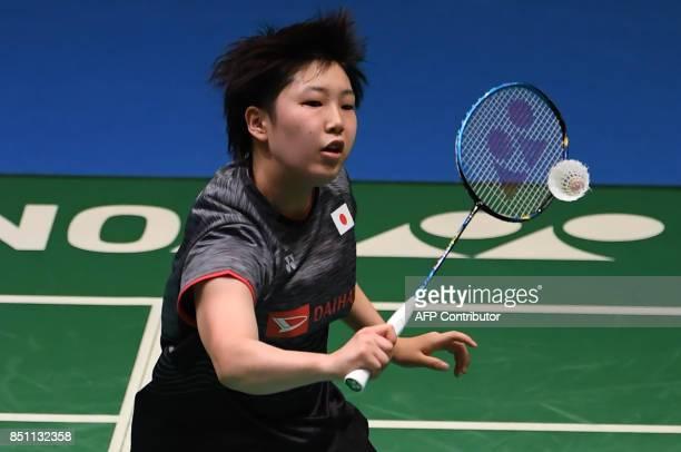 Akane Yamaguchi of Japan hits a return towards Carolina Marin of Spain during the women's singles quarterfinal match at the Japan Open Badmintons...