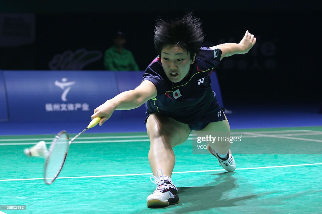 <a gi-track='captionPersonalityLinkClicked' href=/galleries/search?phrase=Akane+Yamaguchi&family=editorial&specificpeople=11382505 ng-click='$event.stopPropagation()'>Akane Yamaguchi</a> of Japan in action during the Women's Singles match against Wang Shixian of China on day three of the BWF 2014 Thaihot China Open at Haixia Olympic Sport Center on November 13, 2014 in Fuzhou, Fujian province of China.