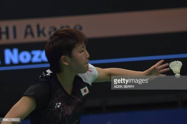 Akane Yamaguchi of Japan plays a return against Nozomi Okuhara of Japan during their women's singles badminton Indonesia Open in Jakarta on June 15...