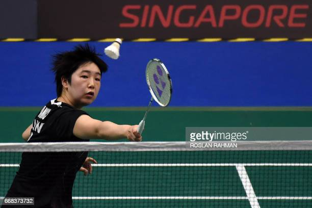 Akane Yamaguchi of Japan plays against Zhang Beiwen of the US during their women's singles quarterfinal of the Singapore Open badminton tournament in...
