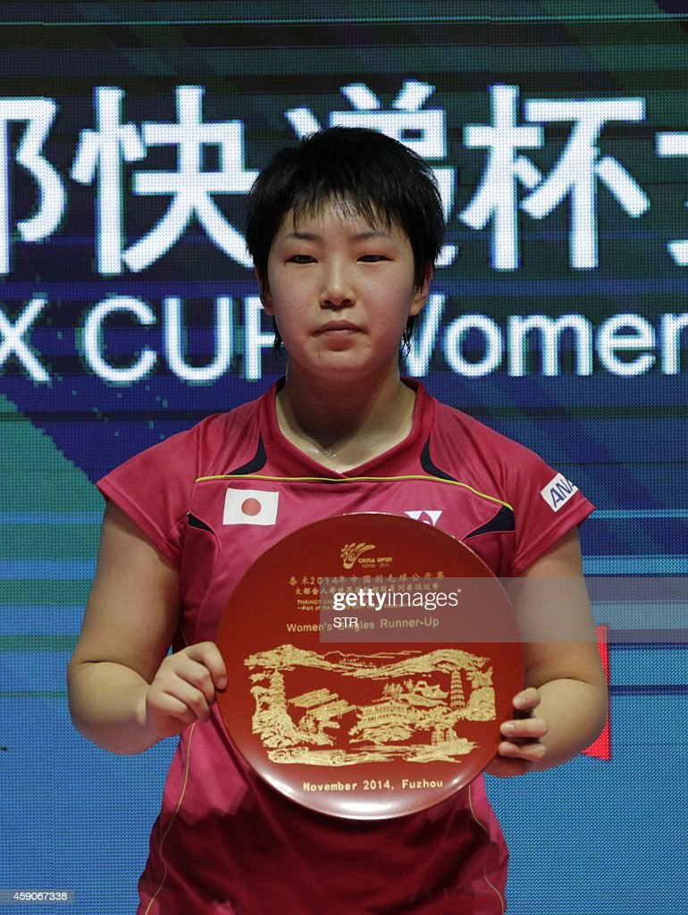 Akane Yamaguchi of Japan poses with her runner s up trophy after