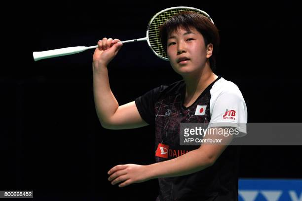 Akane Yamaguchi of Japan reacts during her Australian Open women's singles badminton final against compatriot Nozomi Okuhara in Sydney on June 25...
