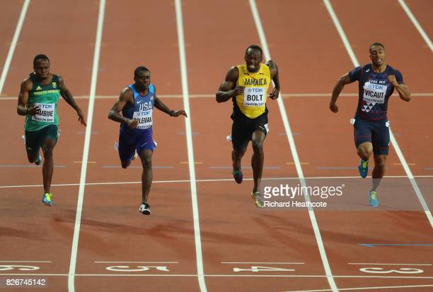 Akani Simbine of South Africa Christian Coleman of the United States Usain Bolt of Jamaica and Jimmy Vicaut of Francea cross the finish line in the...