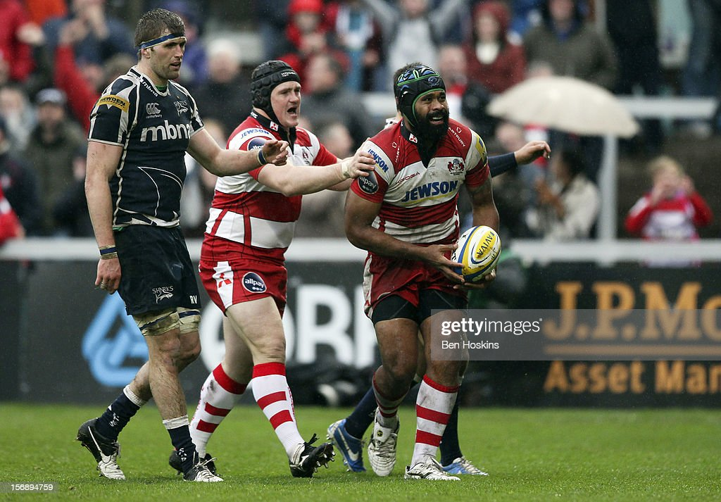 Akapusi Qera of Gloucester (R) celebrates after scoring the opening try of the game during the Aviva Premiership match between Gloucester and Sale Sharks at the Kingsholm Stadium on November 24, 2012 in Gloucester, England.