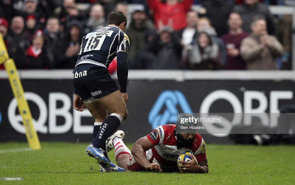 Akapusi Qera of Gloucester dives over to score the opening try of the game during the Aviva Premiership match between Gloucester and Sale Sharks at the Kingsholm Stadium on November 24, 2012 in Gloucester, England.