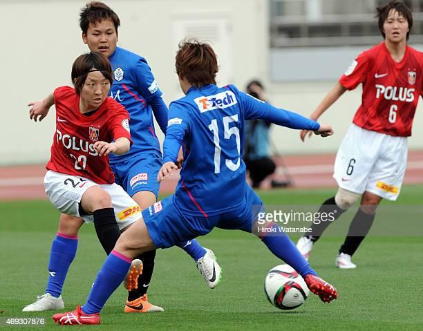 Akari Kurishima of Urawa Reds Ladies and Saori Takahashi of AS Elfen Saitama compete for the ball during the Nadeshiko League match between Urawa Red...
