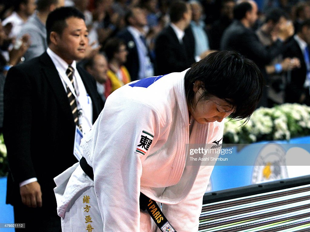 Akari Ogata (white) of Japan reacts after defeated by Audrey Tcheumeo (blue) of France in the Women's -78kg final during day four of the World Judo Championships at the Palais Omnisports de Paris-Bercy on August 26, 2011 in Paris, France.