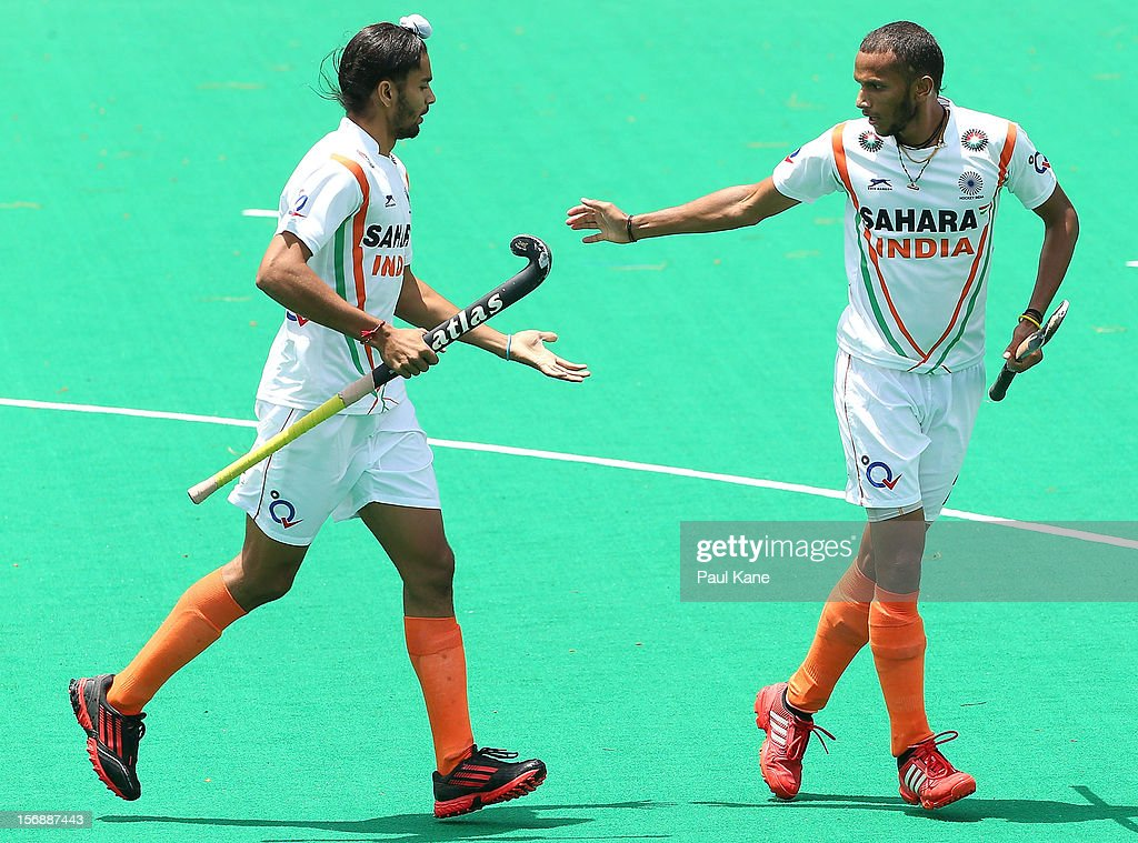 Akashdeep Singh and S.V. Sunil of India celebrate a goal in the mens India v Pakistan game during day three of the 2012 International Super Series at Perth Hockey Stadium on November 24, 2012 in Perth, Australia.