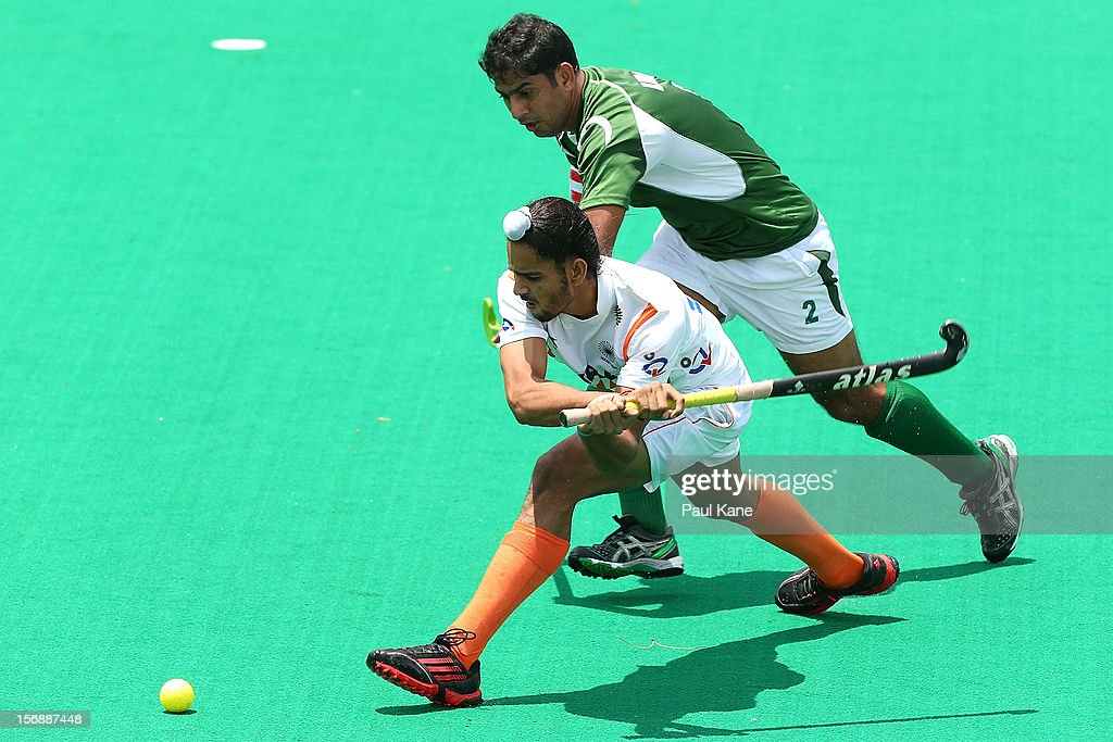 Akashdeep Singh of India passes the ball against Muhammad Imran of Pakistan in the mens India v Pakistan game during day three of the 2012 International Super Series at Perth Hockey Stadium on November 24, 2012 in Perth, Australia.