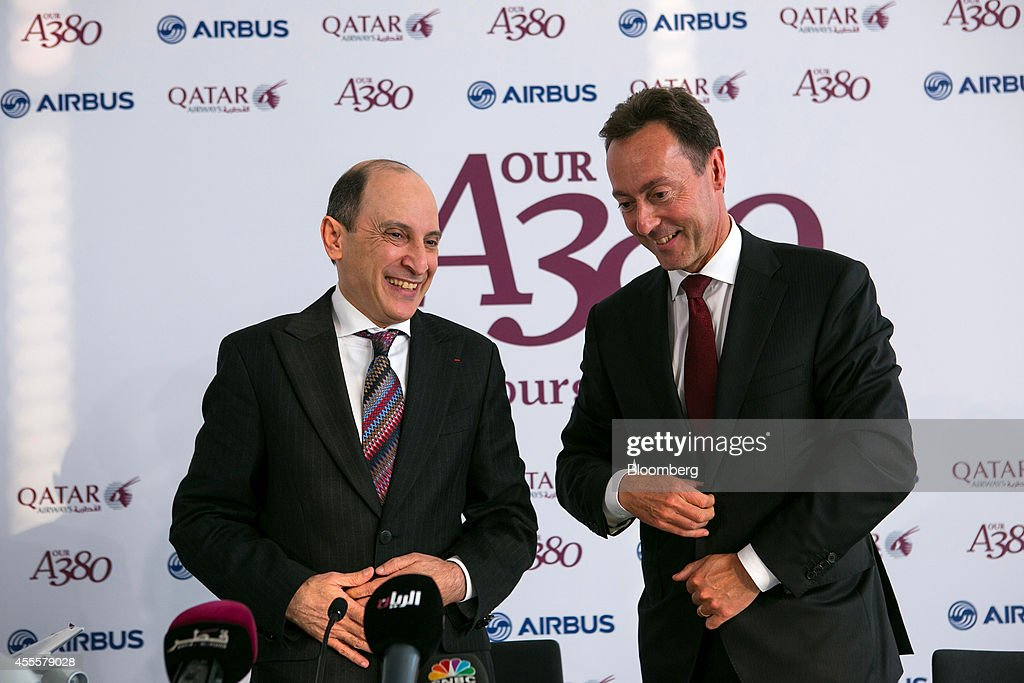Akbar Al Baker, chief executive officer of Qatar Airways Ltd., left, and Fabrice Bregier, chief executive officer of Airbus, smile during a news conference ahead of a delivery ceremony for Qatar Airways first Airbus A380 at the Airbus Group NV factory in Hamburg, Germany, on Tuesday, Sept. 16, 2014. Bregier, speaking at the Airbus factory in Hamburg, where Qatar Airways Ltd. took delivery of its first A380, acknowledged that interest in the largest commercial airliner has been 'soft,' with no deals from airlines so far this year. Photographer: Krisztian Bocsi/Bloomberg via Getty Images