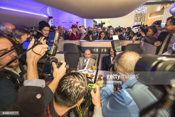 Akbar Al Baker chief executive officer of Qatar Airways Ltd left and Qatar's Sheikh Saoud Bin Abdulrahman AlThani are photographed by the media as...
