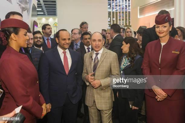 Akbar Al Baker chief executive officer of Qatar Airways Ltd right and Qatar's Sheikh Saoud Bin Abdulrahman AlThani wait to unveil the new seating for...