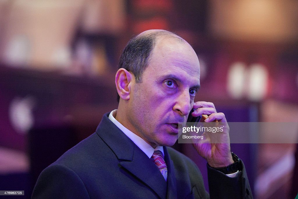 Akbar Al Baker, chief executive officer of Qatar Airways Ltd., speaks on a mobile phone at the company's stand during the ITB travel fair at Messe Berlin exhibition center in Berlin, Germany, on Thursday, March 6, 2014. Al Baker said yesterday his company will be sticking with hard-wired inflight-entertainment systems. Photographer: Krisztian Bocsi/Bloomberg via Getty Images