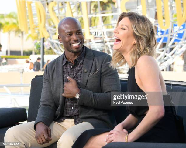 Akbar GbajaBiamila and Charissa Thompson attend 'Extra' at Universal Studios Hollywood on February 16 2017 in Universal City California