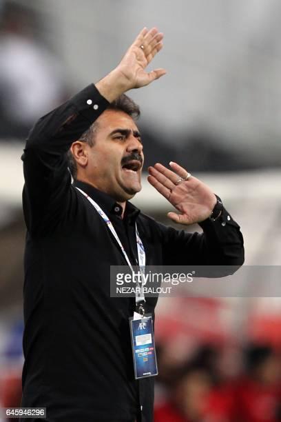 Akbar Pourmousavi head coach of Iran's Esteghlal Khuzestan club gestures during an Asian Champions League Group B football match against UAE's...