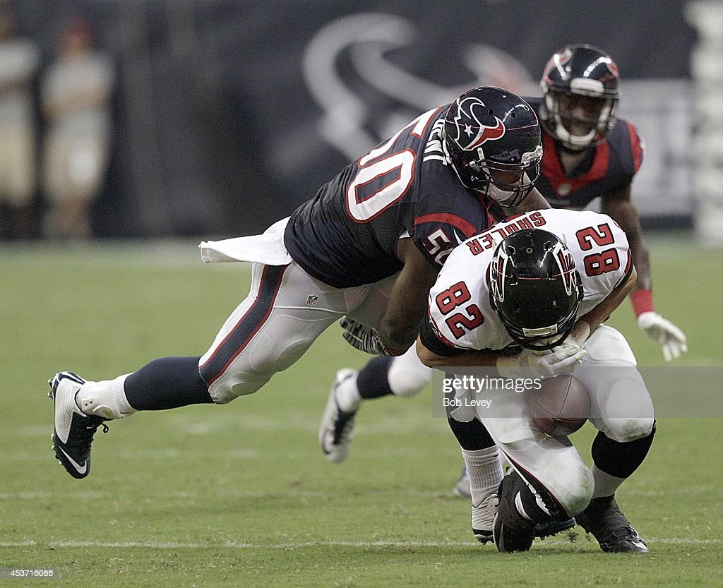 <a gi-track='captionPersonalityLinkClicked' href=/galleries/search?phrase=Akeem+Dent&family=editorial&specificpeople=4650308 ng-click='$event.stopPropagation()'>Akeem Dent</a> #50 of the Houston Texans breaks up a pass intended for Mickey Shuler #82 of the Atlanta Falcons in the fourth quarter in a preseason NFL game on August 16, 2014 at NRG Stadium in Houston, Texas.