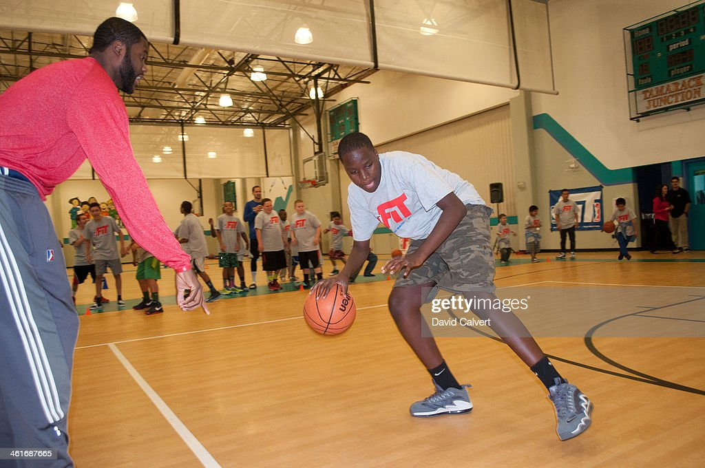 Akeem Ellis of the Rio Grande Valley Vipers works with kids at the Boys & Girls Club of the Truckee Meadows during the NBA D-League FIT clinic part of the 2014 NBA D-League Showcase on January 7, 2014 at the Reno Events Center in Reno, Nevada.