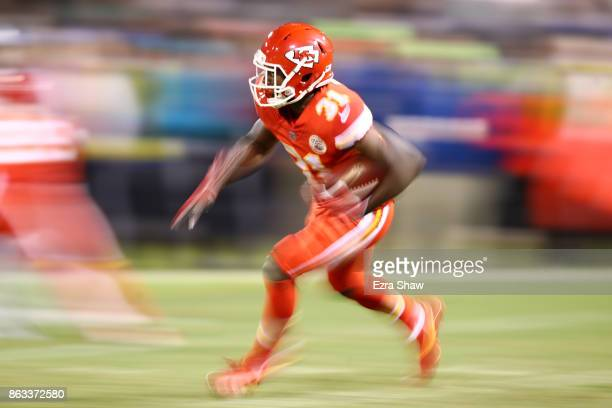 Akeem Hunt of the Kansas City Chiefs rushes with the ball against the Oakland Raiders during their NFL game at OaklandAlameda County Coliseum on...