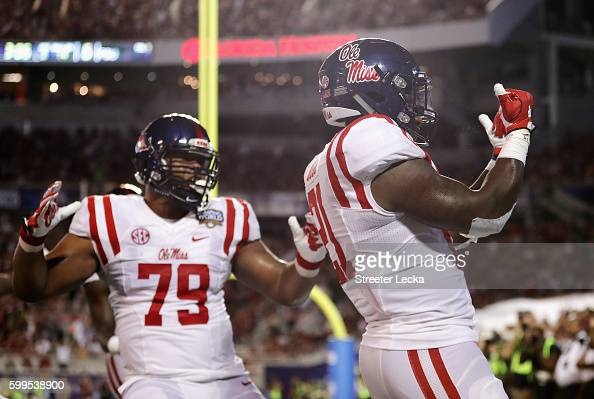 Akeem Judd of the Mississippi Rebels celebrates scoring a touchdown in the second quarter against the Florida State Seminoles during the Camping...