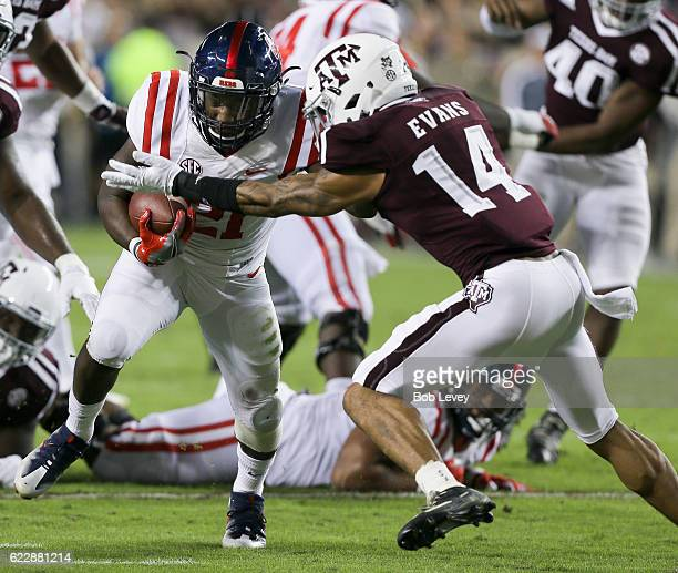 Akeem Judd of the Mississippi Rebels is tackled by Justin Evans of the Texas AM Aggies at Kyle Field on November 12 2016 in College Station Texas