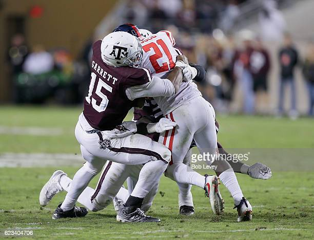 Akeem Judd of the Mississippi Rebels is tackled by Myles Garrett of the Texas AM Aggies at Kyle Field on November 12 2016 in College Station Texas