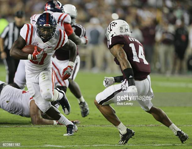 Akeem Judd of the Mississippi Rebels runs past Justin Evans of the Texas AM Aggies at Kyle Field on November 12 2016 in College Station Texas