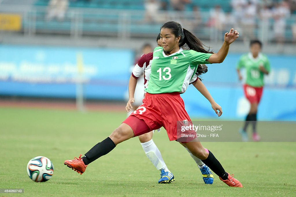 Akemi Yokoyama of Mexico in action during the 2014 FIFA Girls Summer Youth Olympic Football Tournament Semi Final match between Venezuela and Mexico at Wutaishan Stadium on August 23, 2014 in Nanjing, China.