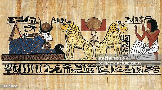 Aker symbol of the sun flanked by the lions Sef and Duau worshiped by the deceased and Hathor papyrus reconstruction of the papyrus of Khonsu extract...