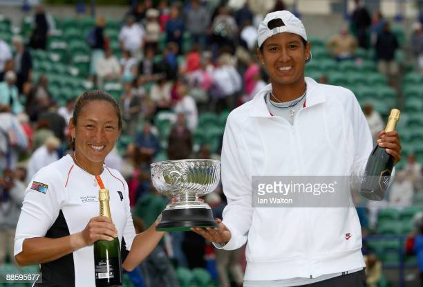 Akgul Amanmuradova of Uzbekistan and Ai Sugiyama of Japan celebrates with the tropy after winning the women's Doubles Final against Rennae Stubbs of...