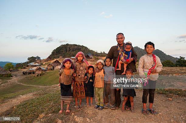 CONTENT] Akha Nuqui Villagers Standing Group Portrait In Their Village In Phongsali Laos
