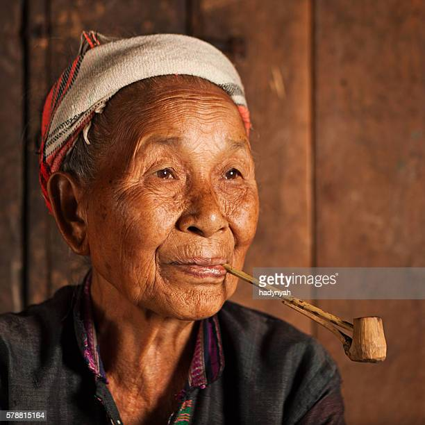 Akha woman smoking a pipe in Northern Laos