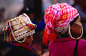 Akha women wearing traditional headwear.