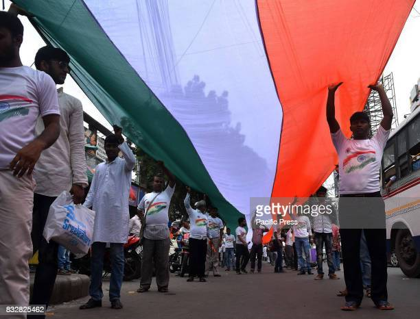 Akhil Bharatiya Vidyrathi Parishad supporters and activists rally with 360 ft Indian Flag on the occasion of 71th Independence day in Kolkata on 15th...