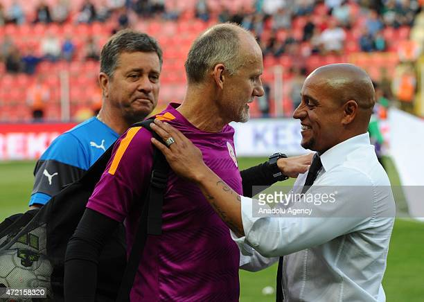 Akhisar Belediyespor's head coach Roberto Carlos talks to Galatasaray's goalkeeping coach Claudio Taffarel during the Turkish Spor Toto Super League...