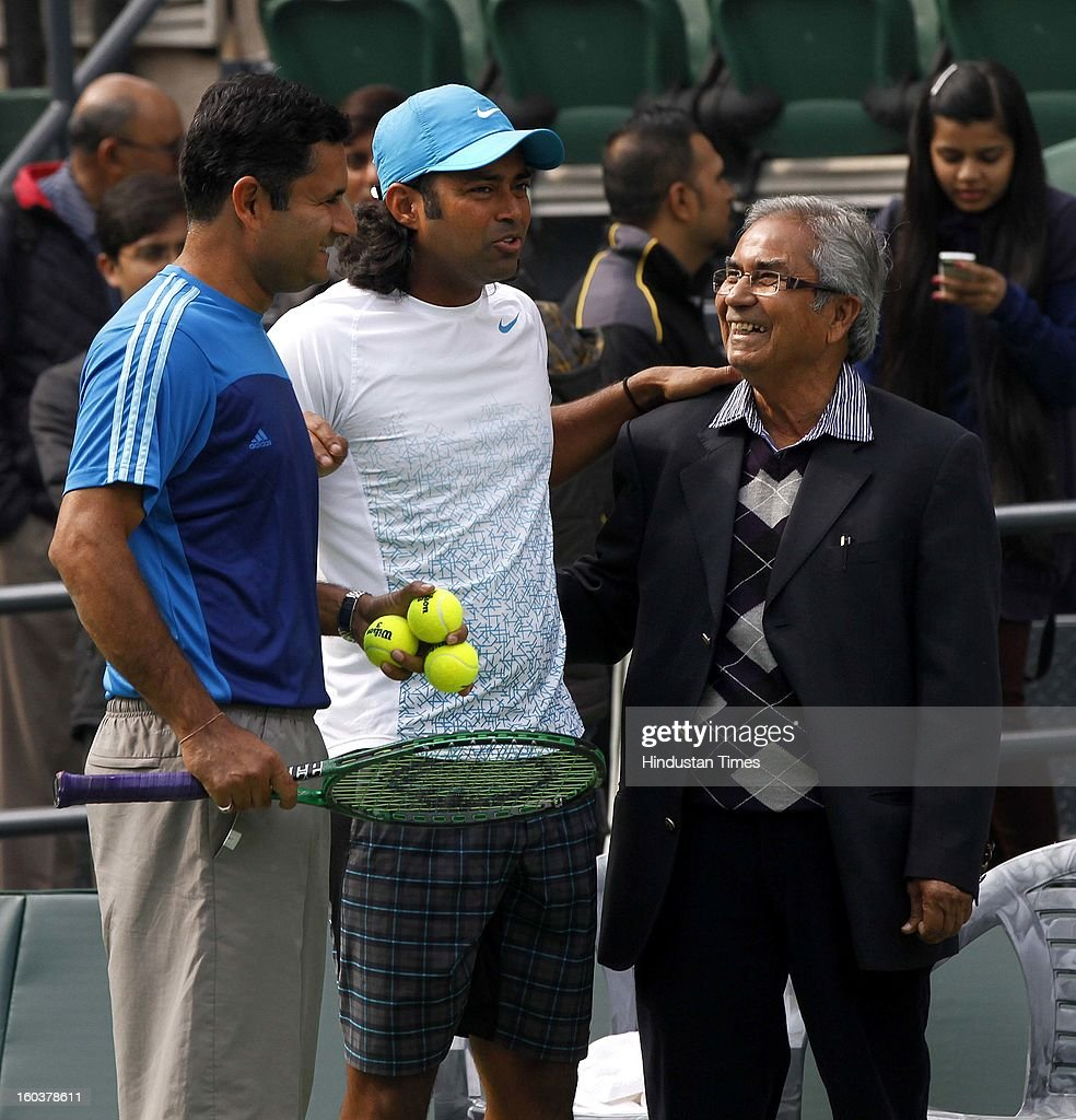 Akhtar Ali former Indian Davis Cup player shares some light moments with his son Zeeshan Ali and Leander Paes during the practice session at DLTA on January 30, 2013 in New Delhi, India. After the rebellion by top Indian tennis players AITA has fielded an inexperienced team for the Davis Cup tie against South Korea that will begin on February 1.