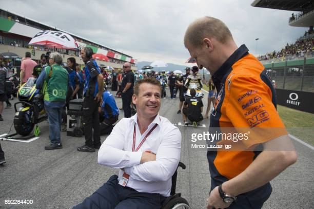 Aki Ajo of Finland speaks with Pit Beirer of Austria on the grid during the Moto2 race during the MotoGp of Italy Race at Mugello Circuit on June 4...