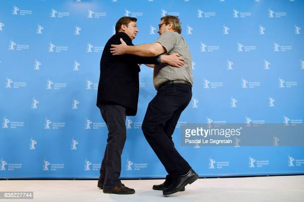 Aki Kaurismaki and Sakari Kuosmanen dance at the 'The Other Side of Hope' photo call during the 67th Berlinale International Film Festival Berlin at...