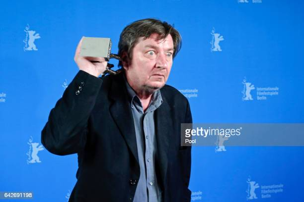 Aki Kaurismaki with his Silver Bear for Best Director poses backstage after the closing ceremony of the 67th Berlinale International Film Festival...